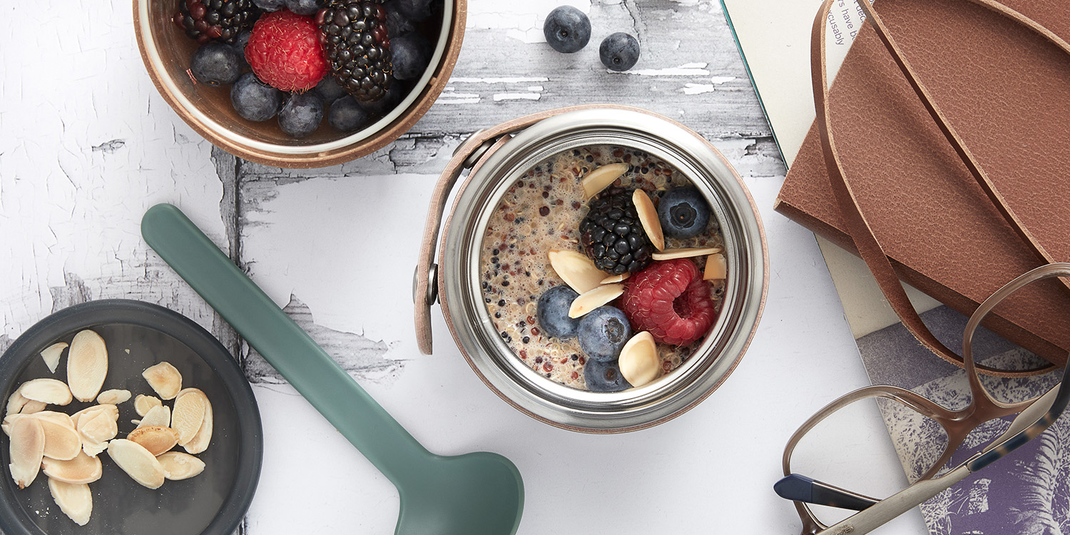 Quinoa and Almond Porridge with berries in insulated stainless steel food flask with spoon